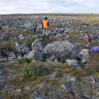 Surveying surface conditions for permafrost studies. Credit: Stephan Gruber.