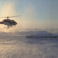 CGG Dighem electromagnetic and horizontal-gradient magnetic system with Helicopter at Yellowknife airport, Northwest Territories. (Credit: NTGS)