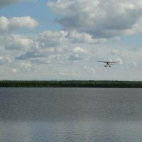 Float plane about to land and deliver supplies.  Credit: NTGS.