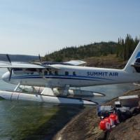 Float plane, lake, outcrop, field gear