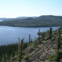 """Hills at """"Fab"""" Lake underlain by volcanic and related rocks of the Great Bear magmatic zone. Credit: NTGS."""