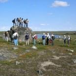students standing on boulder