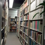 Shelves of books in the NTGO Library. Credit: NTGS.